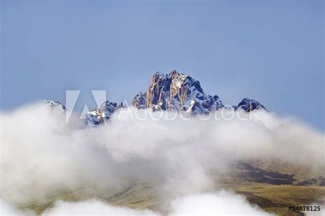 Aerial of Mount Kenya, Africa with snow and white puffy
